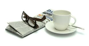newspaper and coffee and glasses 1